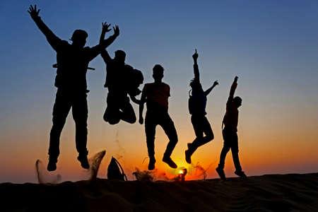 10 Nov 2020 Thar desert, Jaisalmer, Rajasthan, India. Silouette of friends jumping on the sand in Thar desert