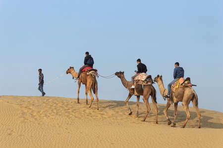 11 Nov 2020 Thar desert, Jaisalmer, Rajasthan, India. Tourists on a camel ride in Thar desert Editorial