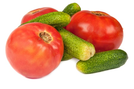 cucumbers and tomatoes on a white background photo