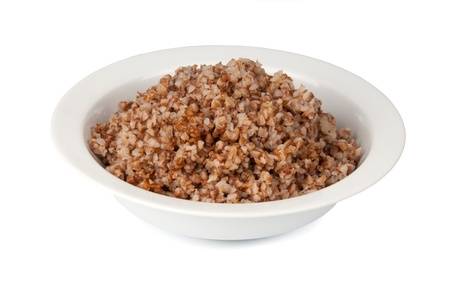 buckwheat in a white bowl on white background Standard-Bild
