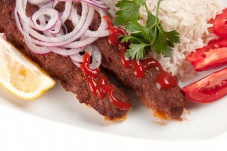 shish kebab: shish kebab with rice on a white background