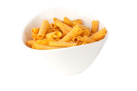 titbits: cheese potato chips in white bowl on a white background Stock Photo