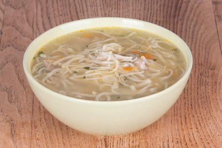 Vermicelli soup with chicken on table photo