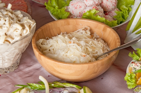 stellate: sauerkraut and different dishes on the holiday table  Stock Photo