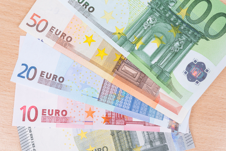 ancestry: Euro banknotes closeup on table