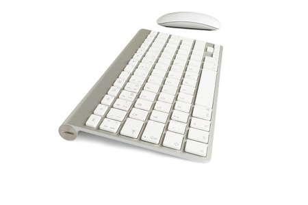 Wireless computer keyboard with the English alphabet and mouse  on white background