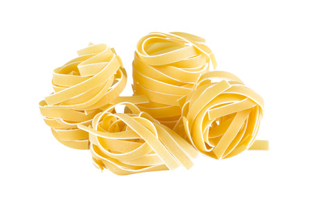 Linguine pasta on a white background