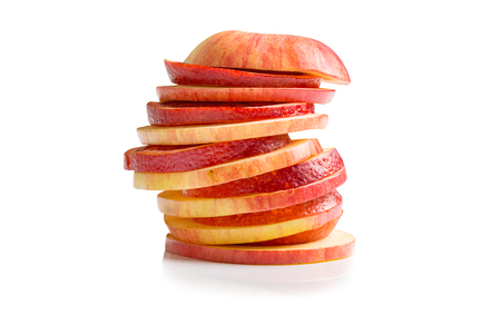 sliced apple: sliced apple and orange on a white background