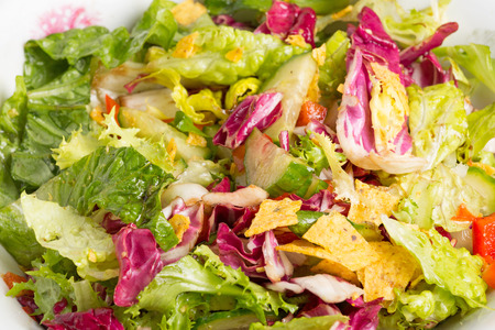 corn chips: mix salad corn chips in a white bowl Stock Photo