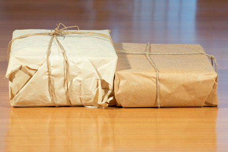 pack string: paper packaging on a wooden table