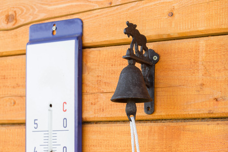 door bell: small rusty bell with a shell  as a door bell Stock Photo