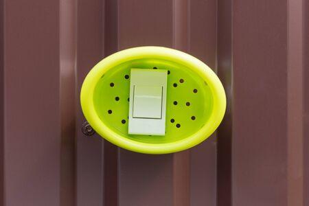 caller: doorbell on the iron fence