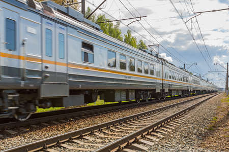 rushes: Passenger train rushes on a sunny day Stock Photo