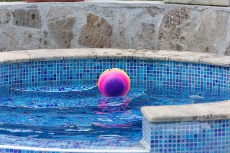 playthings: colorful ball floating in a pool