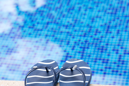 swim shoes: flip-flops on the edge of the pool