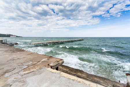 ruined: Sea storm and ruined pier Black Sea in Bulgaria Stock Photo