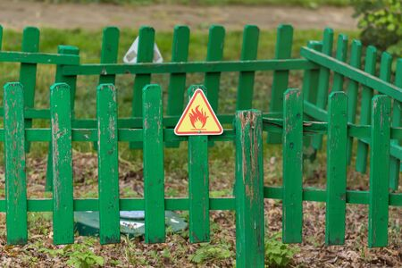forewarn: Fire warning sign on the wooden fence