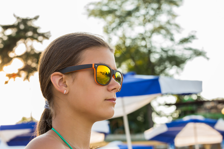 teen bikini: teen girl in sunglasses outdoors