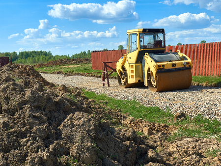 compactor: construction machinery compactor standing on the street Stock Photo