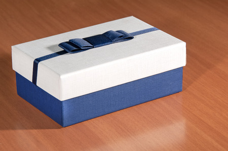 blue box on a wooden table