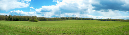 Panorama of the summer landscape with clouds Standard-Bild