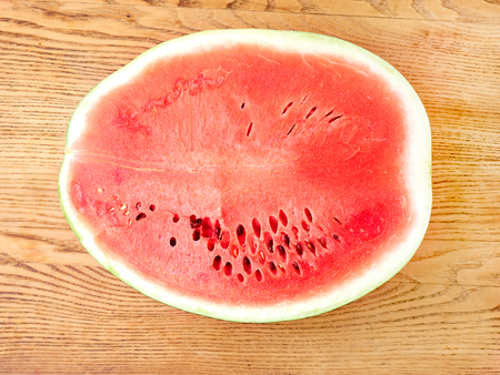 Slice of watermelon on a wooden table