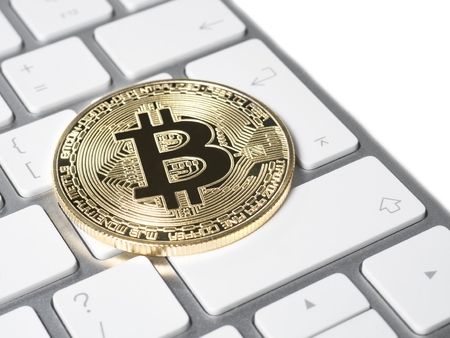 Gold bitcoin crypto currency on the keyboard