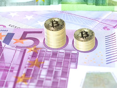 Golden bitcoin column on the background of the euro currency. Standard-Bild
