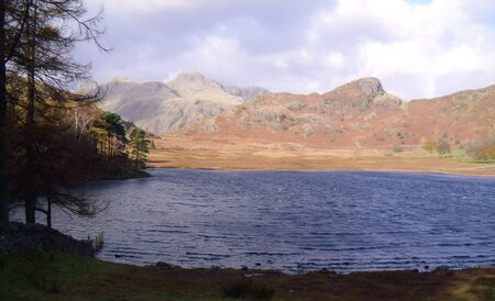 Blea Tarn and The Langdales in Cumbria Stock Photo - 59829976