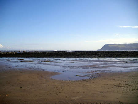 north yorkshire: The beach at Robin Hoods Bay in North Yorkshire with cliffs in the background