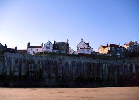 north yorkshire: The sea wall at Robin Hoods Bay in North Yorkshire