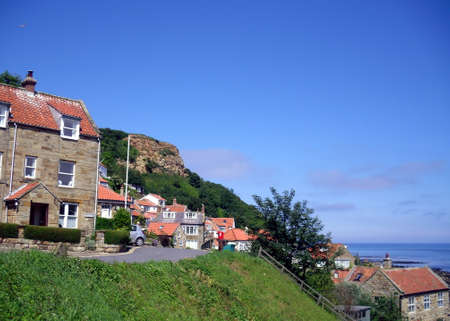 north yorkshire: A View of Runswick Bay Town in North Yorkshire with the Sea in the Background