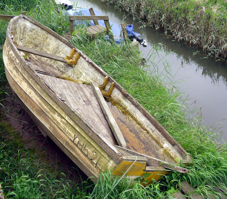 Boat on River Bank at the River Glavon, Cley-next-the-Sea in Norfolk