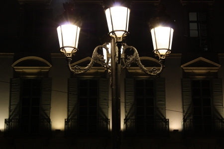 Old iron city lamps on windows shapes photo