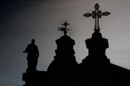 Church black profile with crosses and statue; blue skye and junkies photo