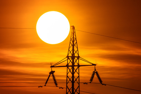 no movement: The electricity pylon with wire and hude sun background it