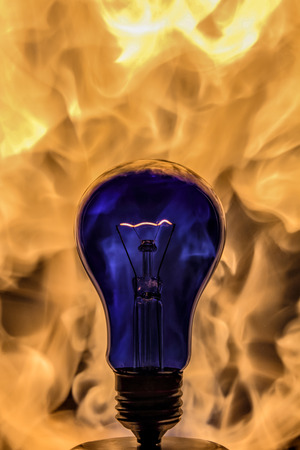 incandescence: The incandescence bulb lamp close up view by fire background