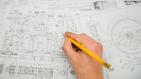 The hand keep pencil and work with blueprints engineering project Stock Photo