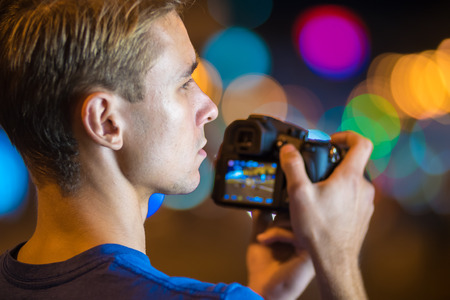 flashers: The man shoot with camera by bright light background Stock Photo