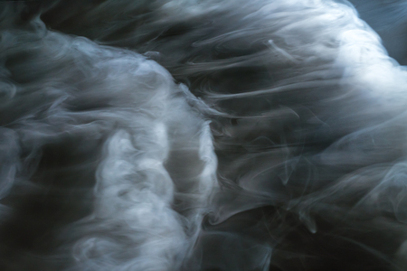 fume: The stream of thick fume on a dark background