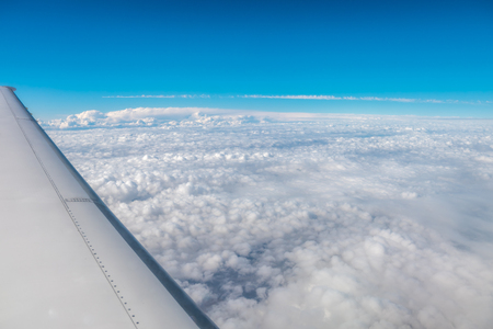 The airplane fly on the background of picturesque cloud. Wide angle Stock Photo