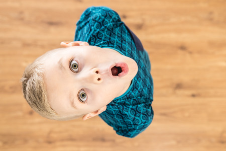 The surprised boy look to the camera. View from above Stock Photo