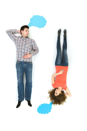 upper floor: The couple lay near the dialog signs. View from above Stock Photo