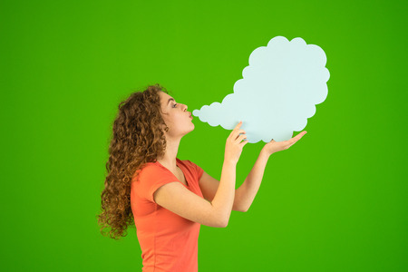 The woman blow a virtual smoke on the green background