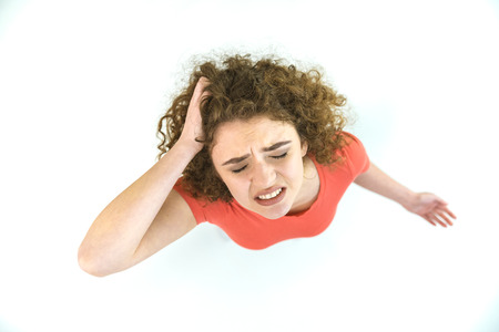 The depressed woman stand on the white background. View from above Stock Photo