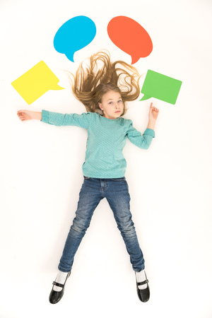 upper floor: The cute girl gesture near the dialog signs. View from above Stock Photo