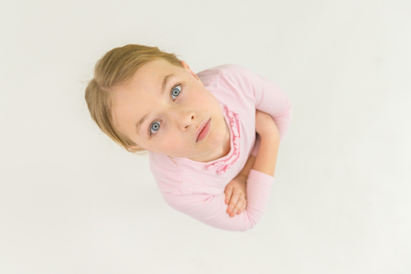 The serious girl look to the camera. View from above Stock Photo