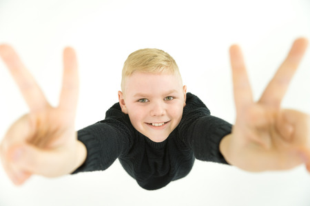The boy gesture to the camera. View from above