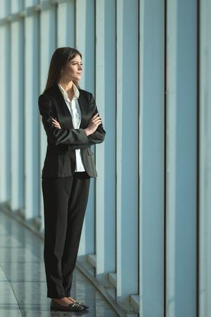 The businesswoman stand near the panoramic window Stock Photo