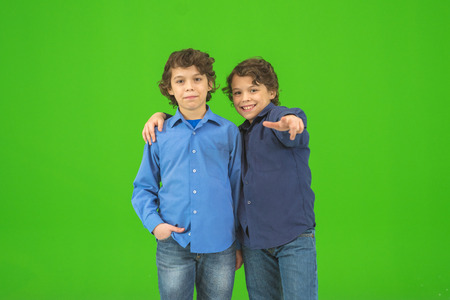 forefinger: The two little twin gesture on the green background Stock Photo